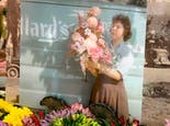 A classic portrait of a floral designer which is still on-display in our Jefferson City location